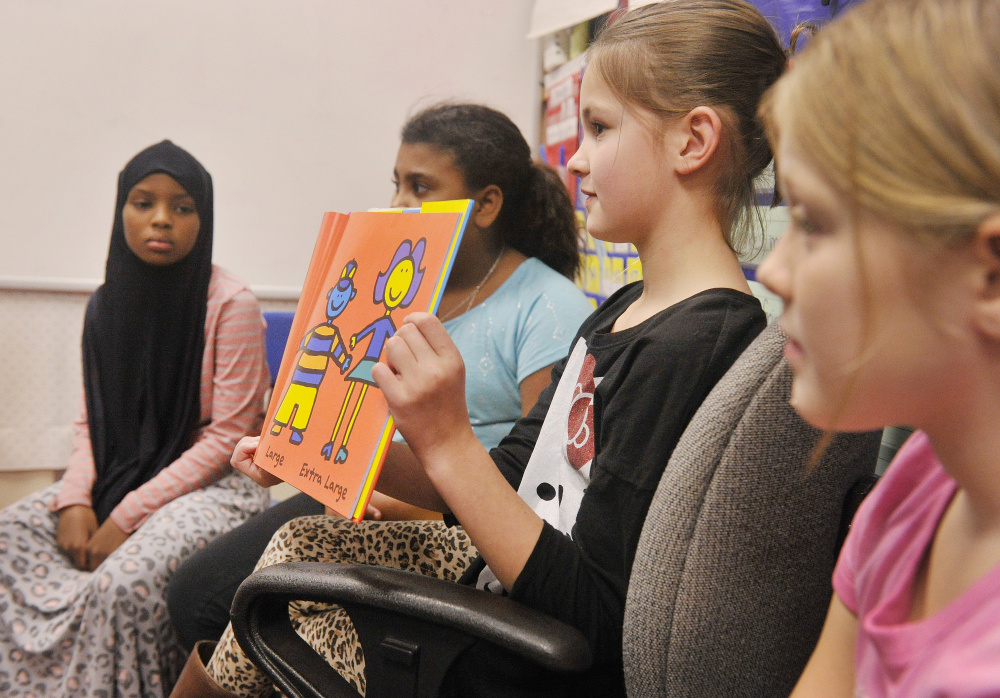Riverton Civil Rights Team members including McKenzie Siton (with book) read to first-graders.  John Ewing/Staff Photographer