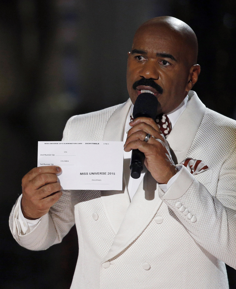 Steve Harvey holds the card showing the winners' names after he crowned the wrong contestant Miss Universe at Sunday's pageant. Miss Philippines took the title.