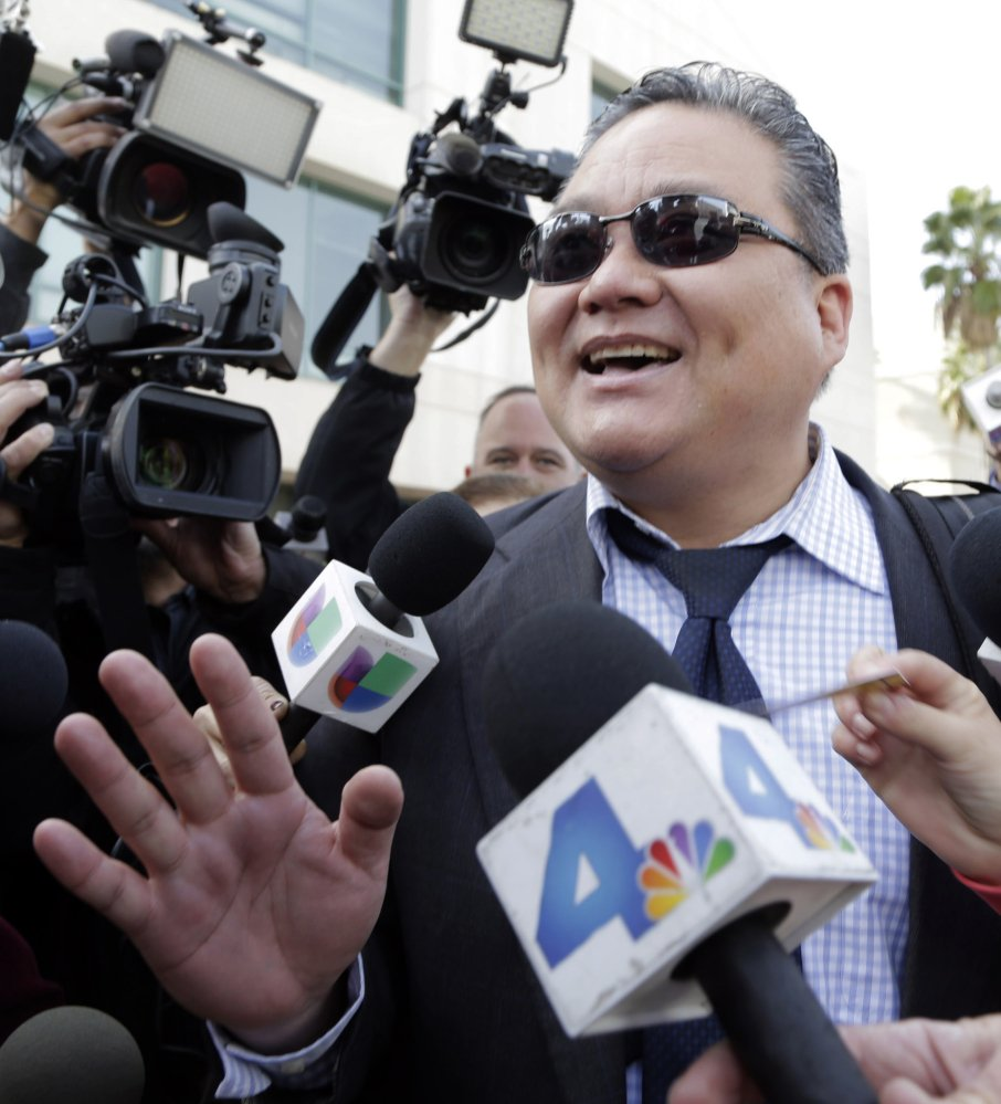 Young Kim, defense attorney for Enrique Marquez, addresses the media Monday in Riverside, Calif.