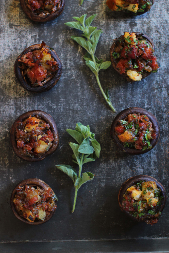 Italian-style stuffed mushrooms, left, and Spanish-style.