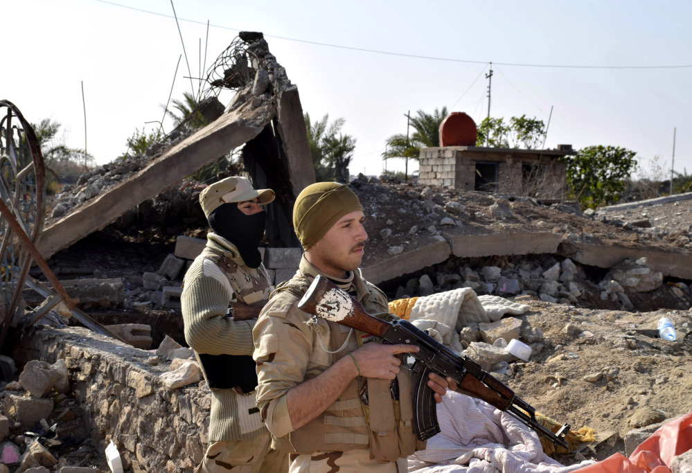 Iraqi soldiers advance in northern Ramadi, 70 miles west of Baghdad, on Monday.