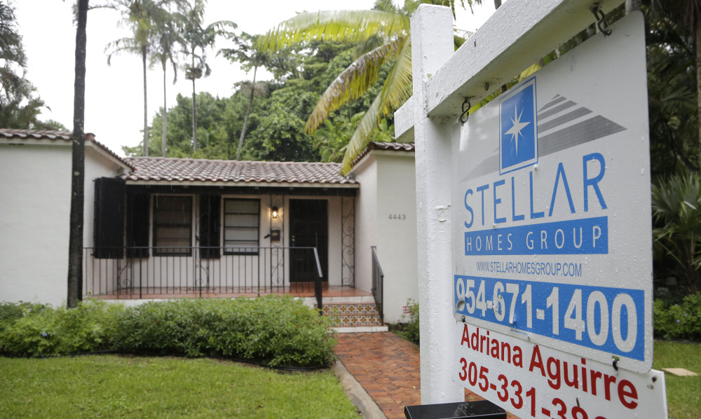 A setback in home sales last month followed solid gains in real estate for 2015. Some of the drop may be accounted for by regulations that may have delayed some closings.