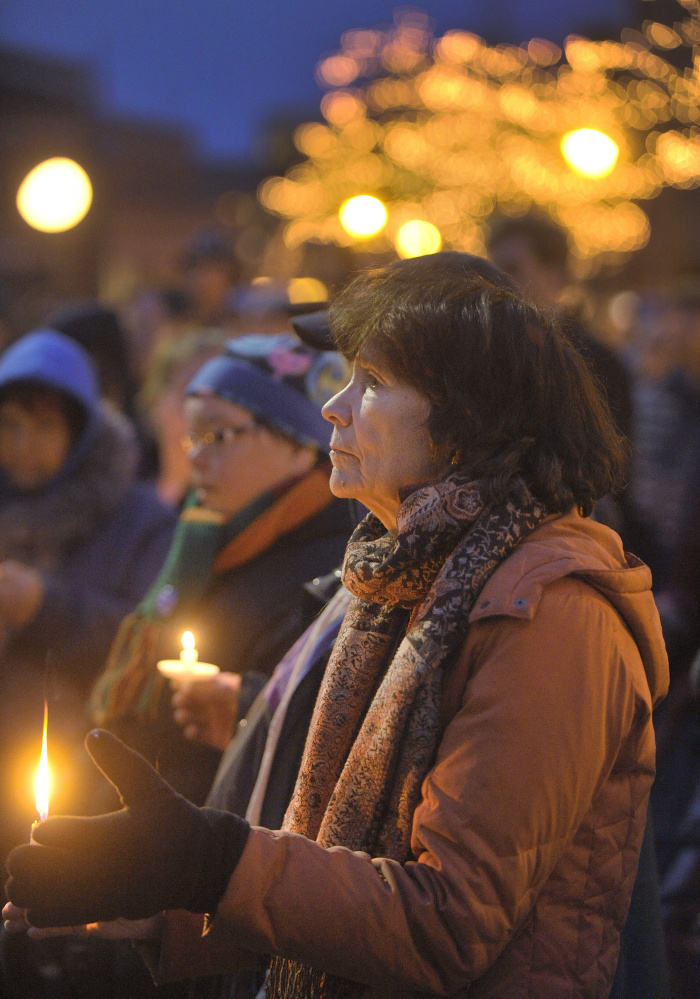 Some people showed their distress over the deaths of 43 homeless people by attending a candlelight vigil Monday evening in Portland.
