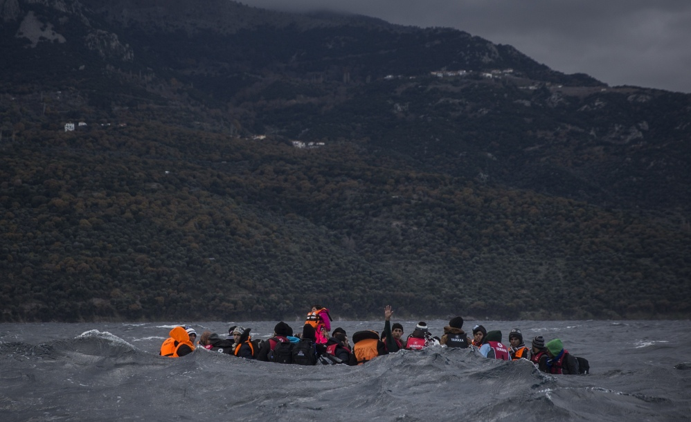 Refugees approach the Greek island of Lesbos on Thursday. According to the International Organization for Migration, 1,005,504 people have entered the EU in 2015.