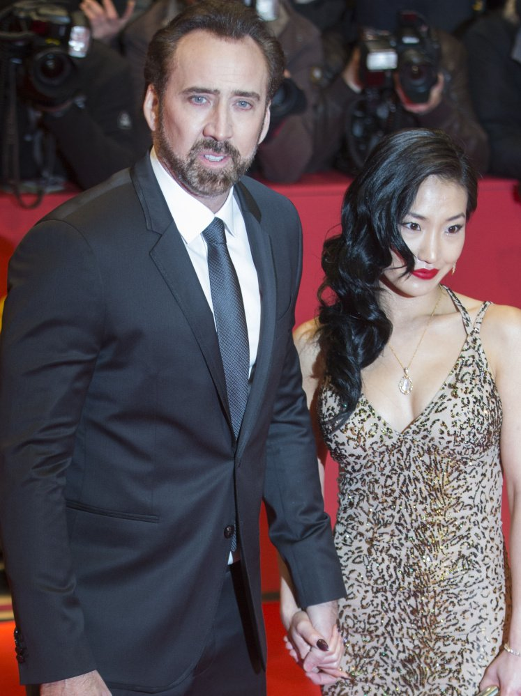 Nicholas Cage, shown with his wife, Alice, unwittingly bought a stolen fossil.