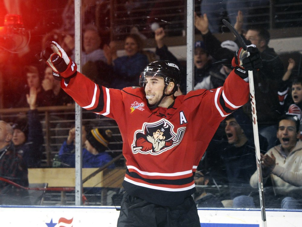 Garrett Wilson celebrates after scoring a goal for the Portland Pirates, tying the game 2-2 and helping spark a comeback and a 4-2 win over Providence on Tuesday night.
