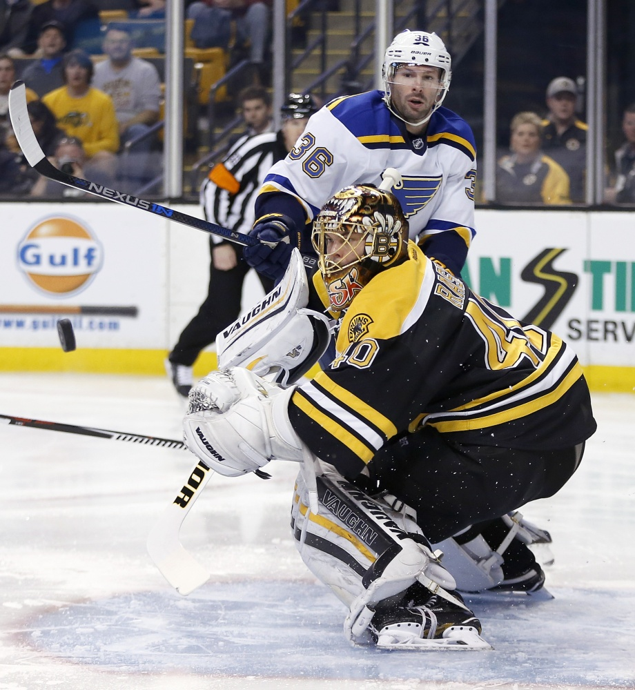 St. Louis' Troy Brouwer watches his shot rebound off Bruins goalie Tuukka Rask in the scoreless first period Tuesday night.