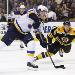 The Blues' Vladimir Tarasenko sets up his scoring shot in the third period as the Bruins' Colin Miller defends. The goal broke a scoreless tie and the Blues went on to win, 2-0.