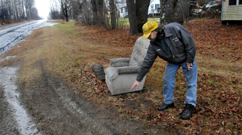 Gerry Bechard points to the area his dog Diesel was hit and seriously injured Monday on Middle Road in Sidney. The Kennebec County Sheriff's Office said the driver of the car told them he tried to swerve to avoid the dog and wasn't even sure he struck it. Its owner told the sheriff Diesel likes to sit next to the chair near the road.