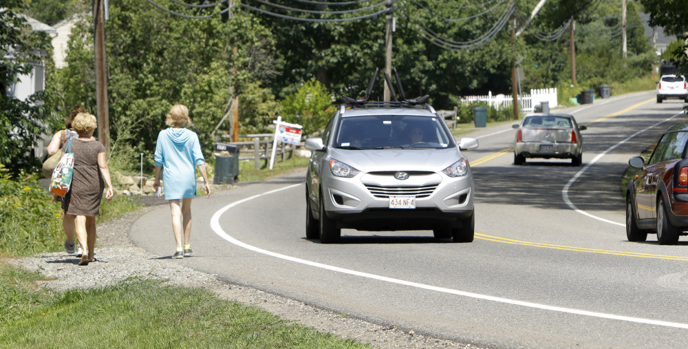Women walk along Ridge Road in York near the site where police say Carolyn Lee, 21, of York, fatally struck a pedestrian, Emily Zarnoch, 23, of Massachusetts in August. Lee has been charged with manslaughter in the case.