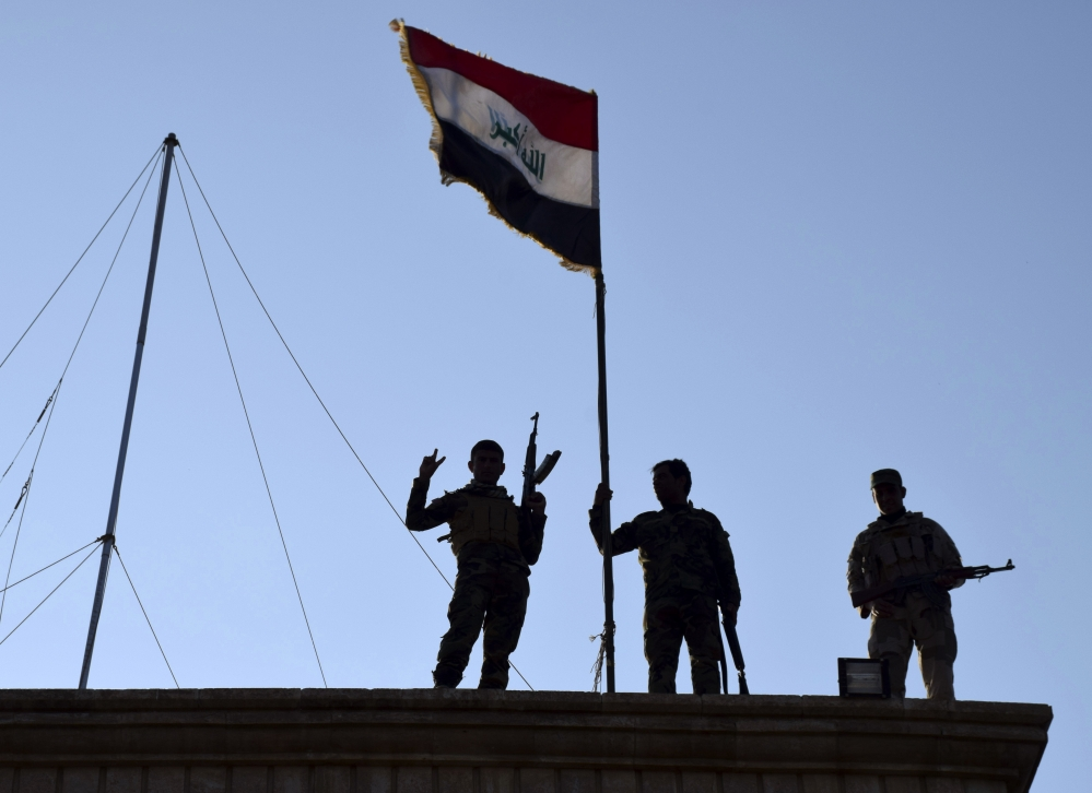 On Monday, Iraqi soldiers planted the national flag over a government building in Ramadi as security forces advanced their campaign to retake the city from the Islamic State.