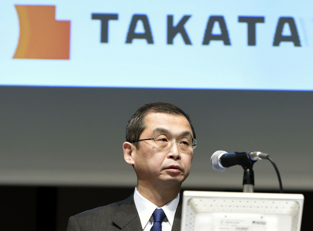 Shigehisa Takada, CEO of Japanese air bag maker Takata Corp., speaks at a news conference in Tokyo in November. Kyodo News via AP, File