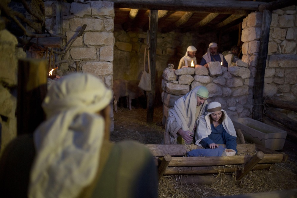 Christian actors portray Joseph and Mary during a re-enactment of the birth of Jesus Christ in the northern Israeli city of Nazareth on Tuesday. The biblical story has a message that's important to all Americans – whether or not they are religious.
