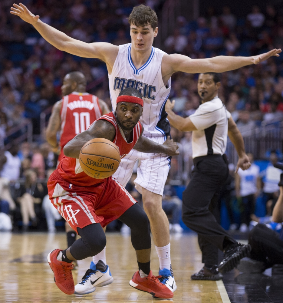 Houston Rockets guard Ty Lawson dribbles the ball as Magic guard Mario Hezonja defends during the second half of their game in Orlando, Fla., on Wednesday night. Orlando came away with a 104-101 win.