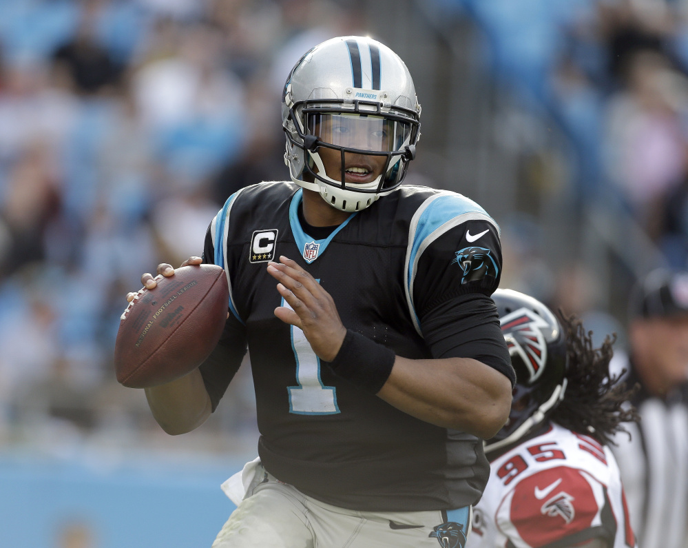 Cam Newton is well known for his running ability, but his passing this season – his 33 touchdowns is second to only Tom Brady's 35 – has helped the Panthers win all their games.