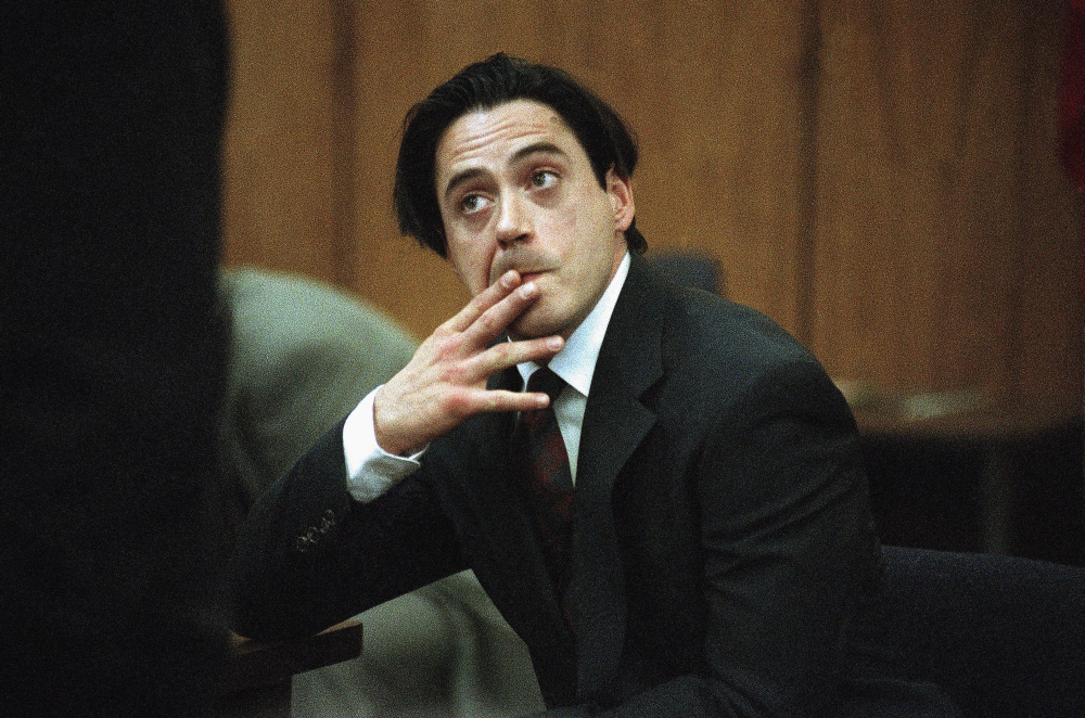 Robert Downey Jr. listens in a Malibu, Calif., courtroom during his 1997 sentencing for violating parole on a prior drug conviction.