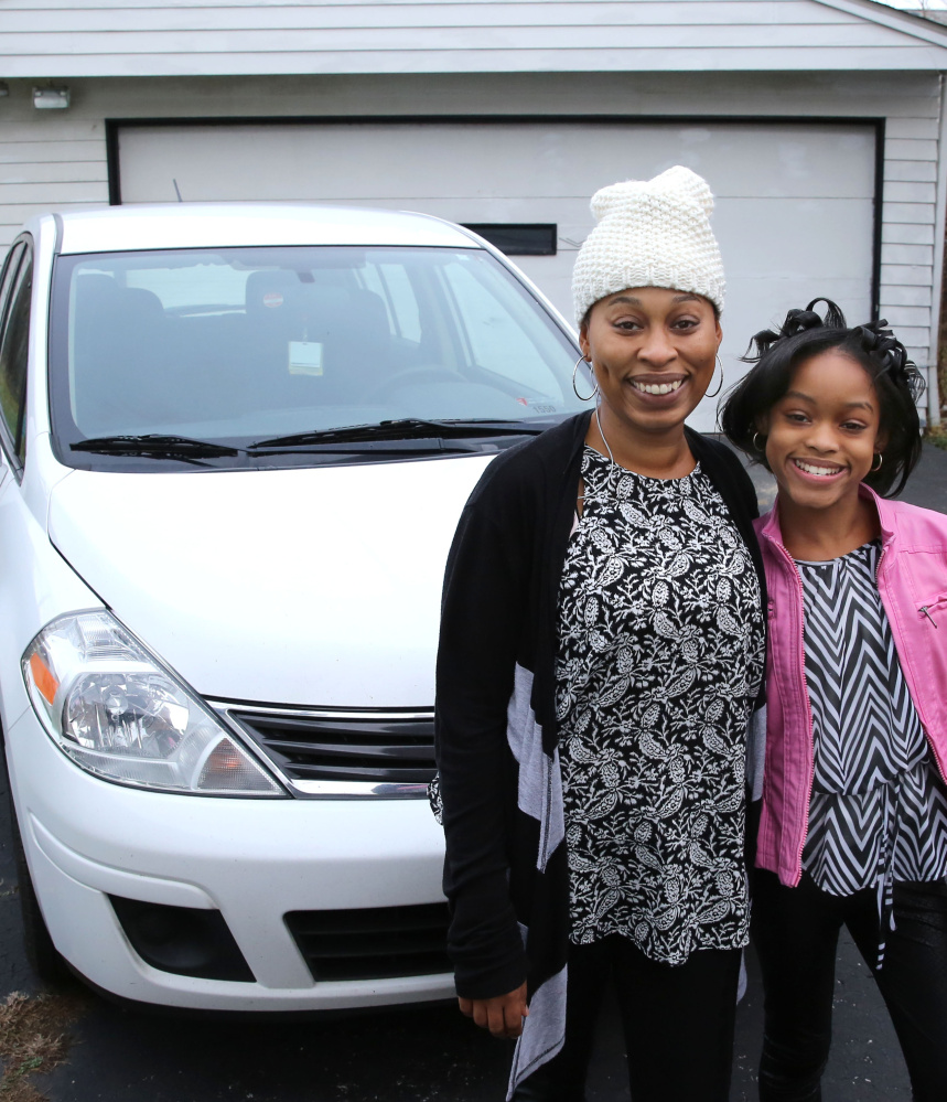 Diana Parks and her daughter Ania are considerably happier in Garfield, Ohio, after a planned repossession of their 2011 Nissan Versa became an uplifting Christmas story instead.