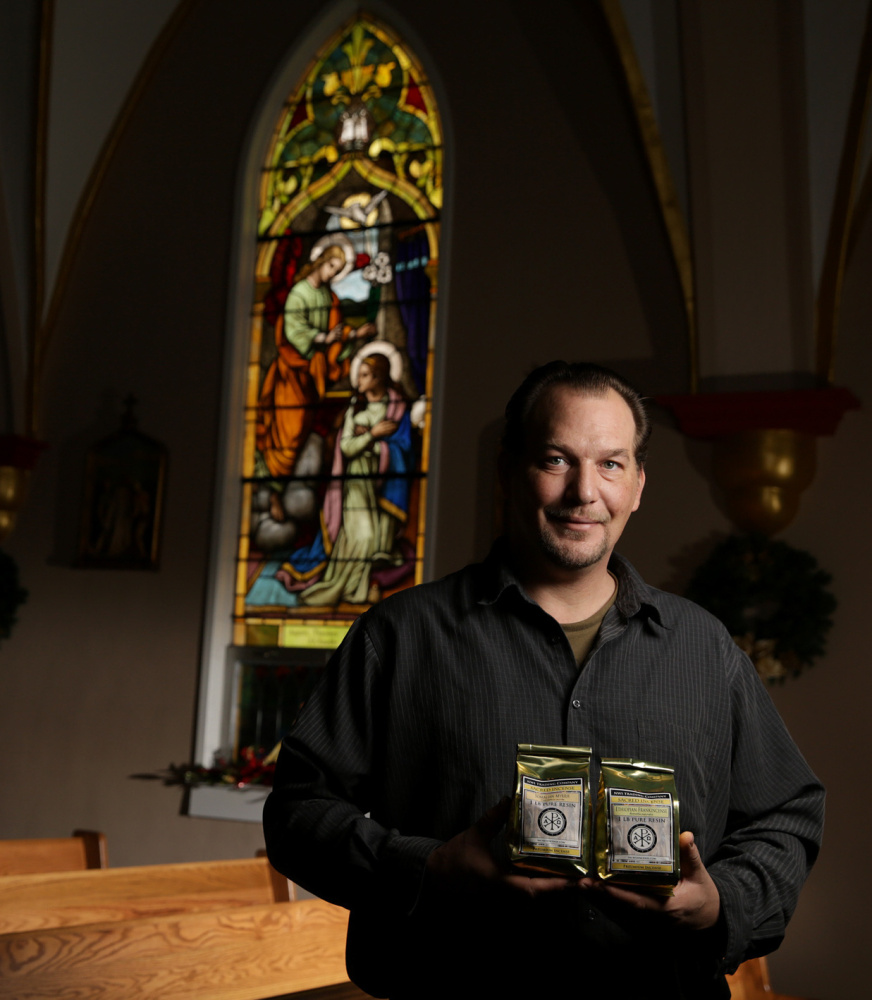 Ryan Bambrick, owner of Northwest Indiana Trading Co., holds bags of frankincense and myrrh that his company sells along with essential oils and ginseng.