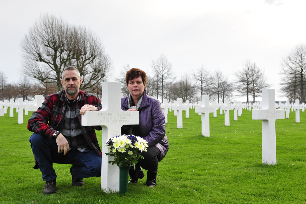 Jos and Monique Krick place flowers at the grave of Pfc. Linton Lowell of Portland, who was killed in action while serving with the U.S. Army in World War II and was buried in the Netherlands American Cemetery in Margraten.