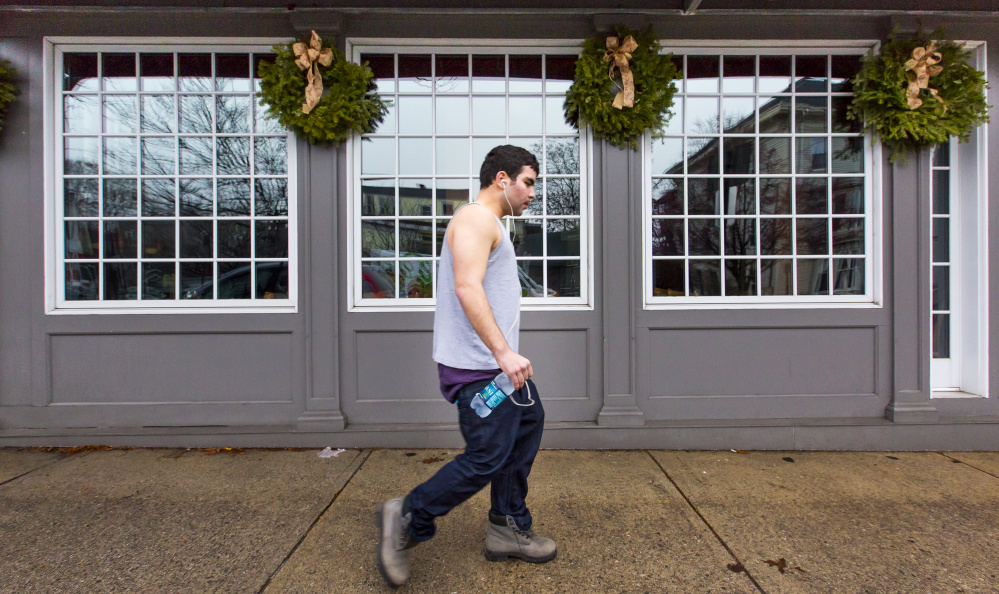 Ali Sayed of Portland walks on Munjoy Hill on Dec. 24, another balmy day in Portland. Ben McCanna/Staff Photographer