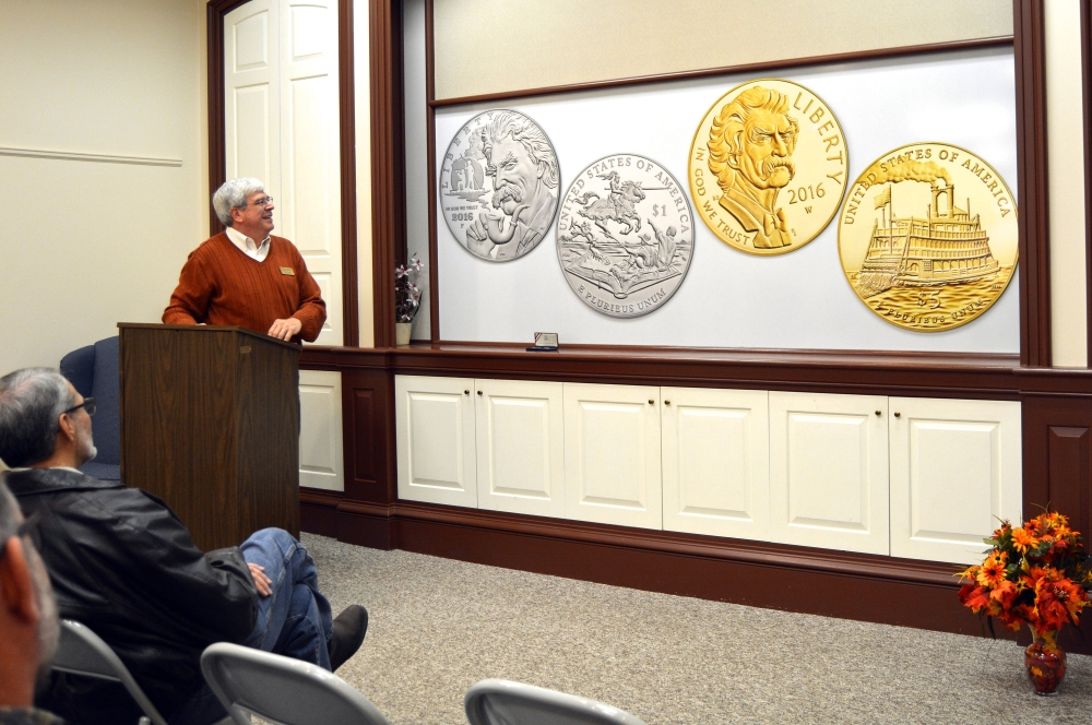 Henry Sweets, executive director of the Mark Twain Boyhood Home & Museum in Hannibal, Mo., unveils the design for commemorative gold and silver Mark Twain coins that will be sold starting next year. Some of the proceeds of the coin sales benefit four Twain-related sites, including the Hannibal home and museum.