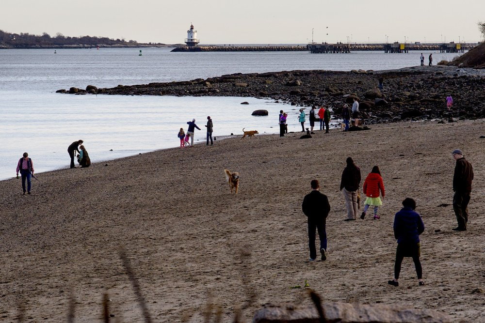 Portland's East End Beach was a popular place on Christmas, a day of record-setting warmth in over Maine.