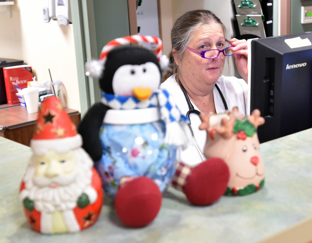 Brenda Roach, a nurse at Inland Hospital in Waterville, works Christmas Day in the emergency room. She says people are often really sick if they leave family celebrations to come in.