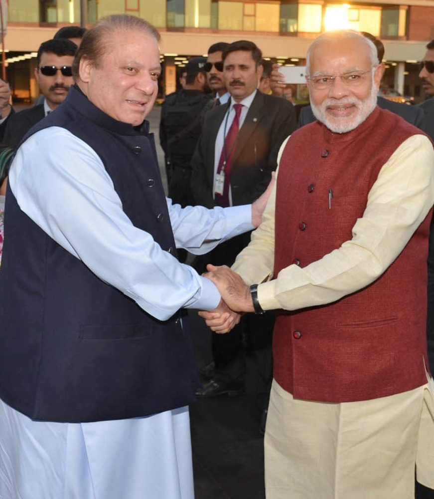 India's Prime Minister Narendra Modi, right, dropped in on his Pakistani counterpart, Nawaz Sharif, in Lahore on Friday. Analysts say the surprise visit bodes well for  relations between the two countries.