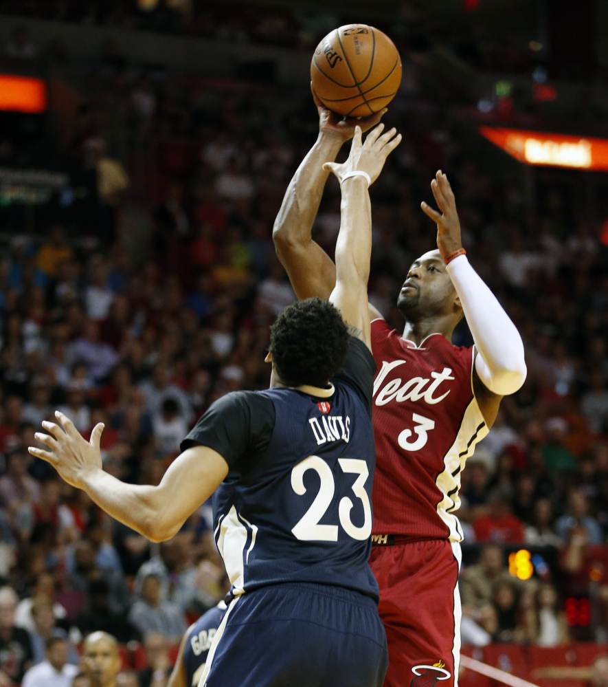 Miami's Dwyane Wade shoots against New Orleans' Anthony Davis during the second half of Friday's game in Miami, won by the Heat, 94-88 in overtime.