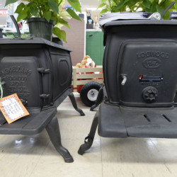 "As of Jan. 1, stoves like these ""EPA-exempt"" models from Vogelzang, left, and Logwood, on display at Paris Farmers Union in Jay, will no longer be sold by U.S. retailers. New rules don't apply to homeowners, however, who can resell units that are not in compliance with emission standards."