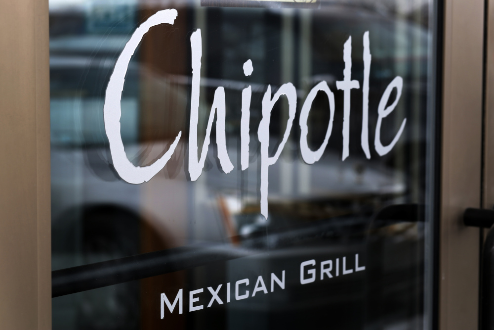 A Chipotle restaurant near Boston College has reopened several weeks after 136 patrons fell ill with norovirus.