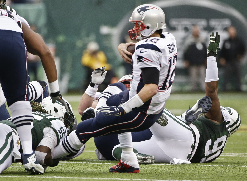 New York Jets outside linebacker Lorenzo Mauldin sacks New England Patriots quarterback Tom Brady in the third quarter Sunday at East Rutherford, New Jersey.