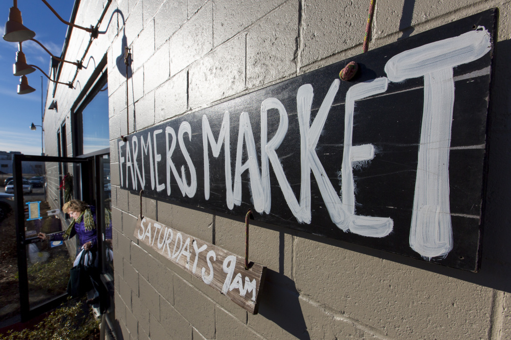 A customer exits the Portland Winter Farmers Market at its new location, 84 Cove St.