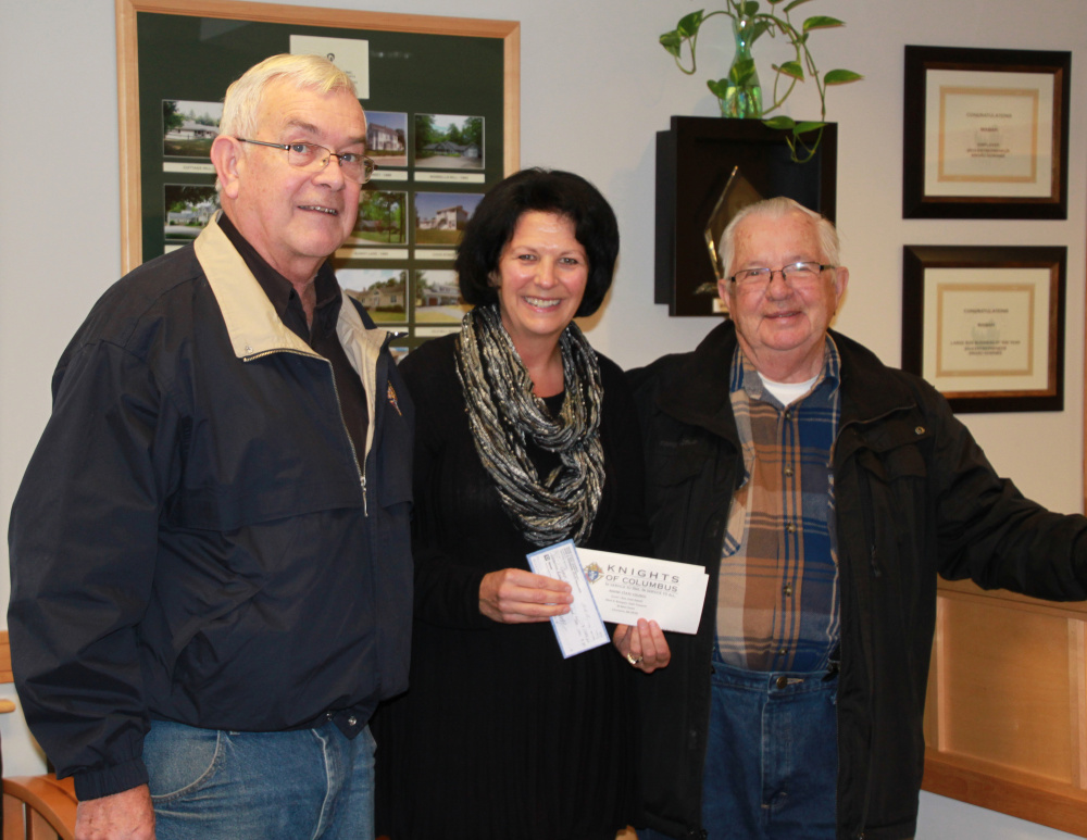 Gervaise Flynn, center, assistant executive director of Waban at Sanford, receives a donation of $1,784.60 from Knights of Columbus St. Thomas Council member Frank Pease and Knights of Columbus Springvale Council member George Watson. The money was raised by the K of C's Tootsie Roll Drive and was pledged to kick off the 45th Annual Waban Telethon, set for March 19. In 2016, Waban will celebrate its 50th year of providing services for children and adults with intellectual/developmental disabilities. Photo courtesy Selena Brock