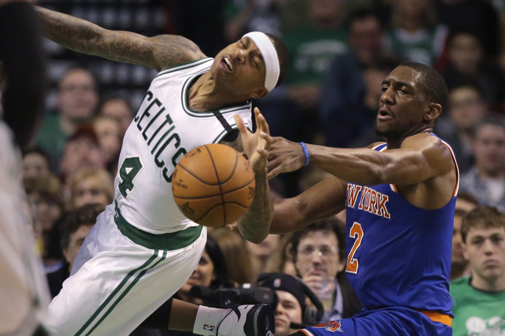 Celtics guard Isaiah Thomas, left, tries to drive to the basket past Knicks guard Langston Galloway, right, during the Celtics' 100-91 win Sunday in Boston. Thomas scored 21 points.