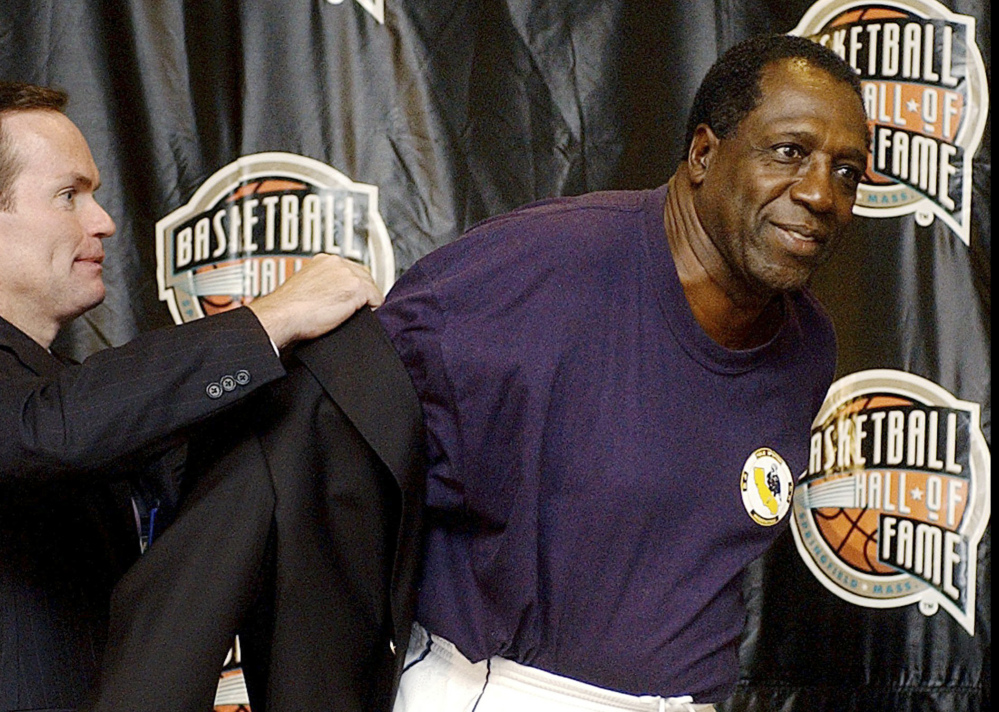 In this 2003 file photo, Basketball Hall of Fame CEO John Doleva, left, presents a Hall of Fame jacket to inductee Meadowlark Lemon of the Harlem Globetrotters in Springfield, Mass.
