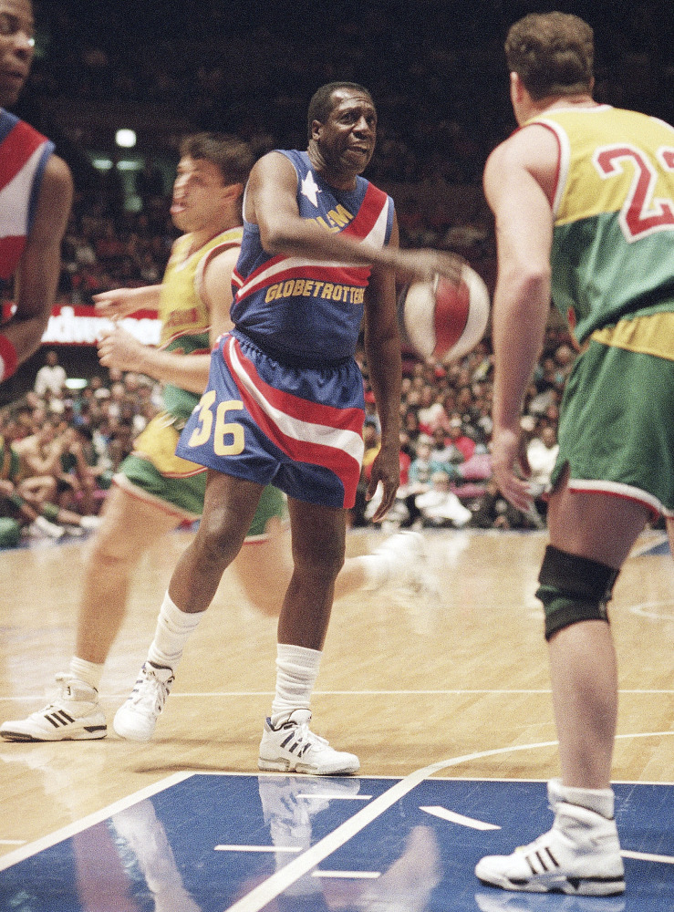 In this 1993 file photo, legendary Harlem Globetrotters' Meadowlark Lemon prepares to put the moves on Washington Generals' Tim Burkhart at Madison Square Garden in New York.