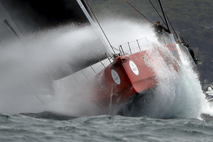 Maxi yacht Comanche powers through heavy swells outside Sydney's harbor during the 71st Sydney to Hobart Yacht race, Australia's premiere bluewater classic race, on Dec.26, 2015.