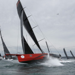Comanche, center, shown in Sydney Harbor during the 71st Sydney to Hobart Yacht race in 2015, has broken a trans-Atlantic crossing record.