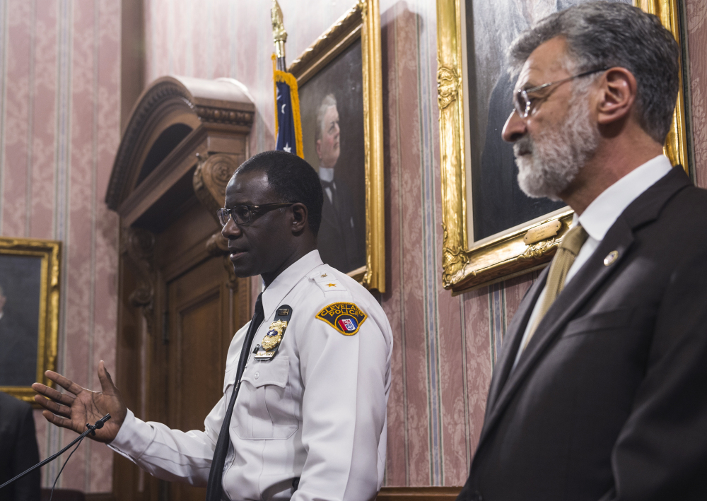 Cleveland Police Chief Calvin Williams answers questions as Mayor Frank Jackson watches during a news conference Monday after a Cuyahoga County grand jury decided not to indict Cleveland police officer Timothy Loehman in the shooting death of 12-year-old Tamir Rice. Jackson said the city and the police department plan an internal review that could lead to discipline against the two officers who were involved.