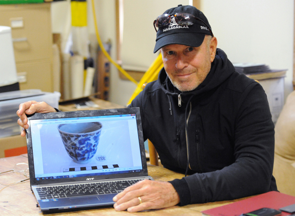 Underwater explorer Barry Clifford displays an image of a Kangxi period Chinese porcelain cup found in the Fiery Dragon shipwreck off Madagascar. Clifford plans to display artifacts recovered from the 300-year-old pirate ship Whydah in a museum in West Yarmouth, Mass.