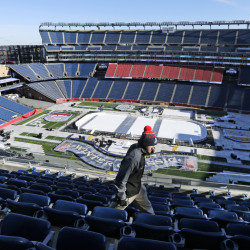 Workers are busy turning Gillette Stadium into an outdoor hockey arena for the Winter Classic between the Boston Bruins and the Montreal Canadiens on New Year's Day.