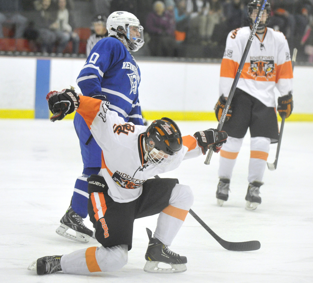 Curtis Petit of Biddeford celebrates after scoring in the second period. It was one of the four goals in the period that put the game away for the Tigers.