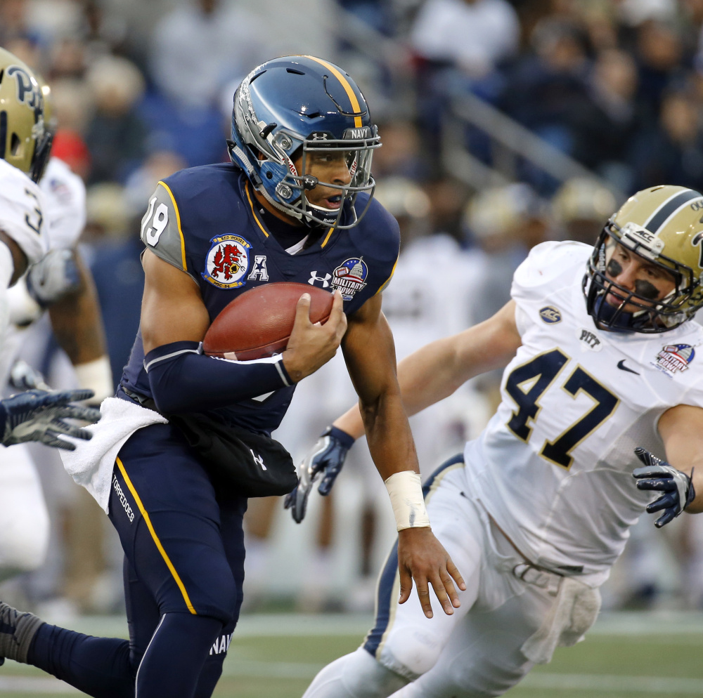 Navy quarterback Keenan Reynolds, center, ran for three touchdowns in Navy's 44-28 win over Pittsburgh in the Military Bowl on Monday in Annapolis, Maryland.