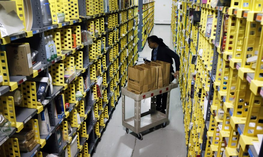 Amazon Prime employee Alicia Jackson hunts for items at the firm's urban fulfillment facility in New York last week.