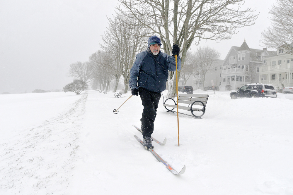 The area's first snowstorm brought people out to play as well as to shovel. Brian O'Connor of Portland donned his cross-country skis for the first time this season and ventured out onto the Eastern Prom.