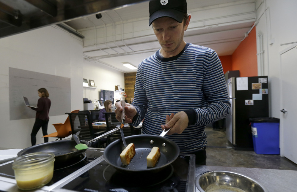 Hampton Creek Foods pastry chef Ben Roche prepares french toast made with Just Scramble in San Francisco. Hampton Creek's mission is to replace the eggs in products without anyone noticing.