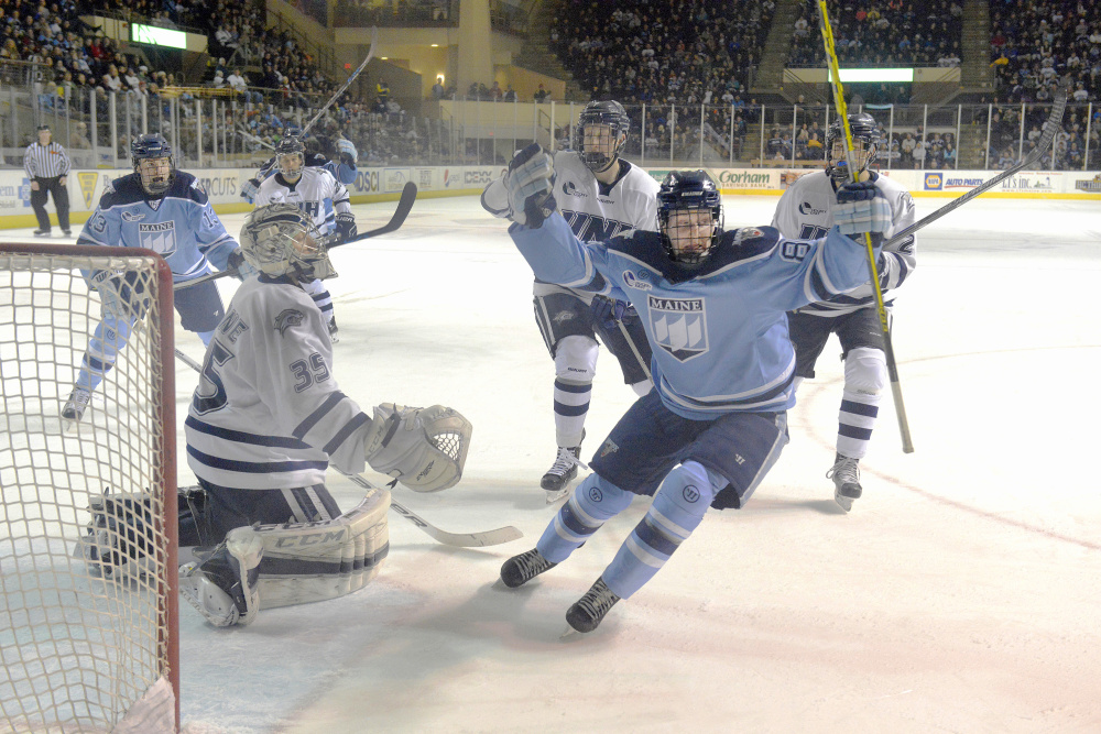 Brian Morgan of the University of Maine celebrates after scoring in the second period Tuesday night against New Hampshire at the Cross Insurance Arena in Portland. New Hampshire came away with a 5-4 victory.