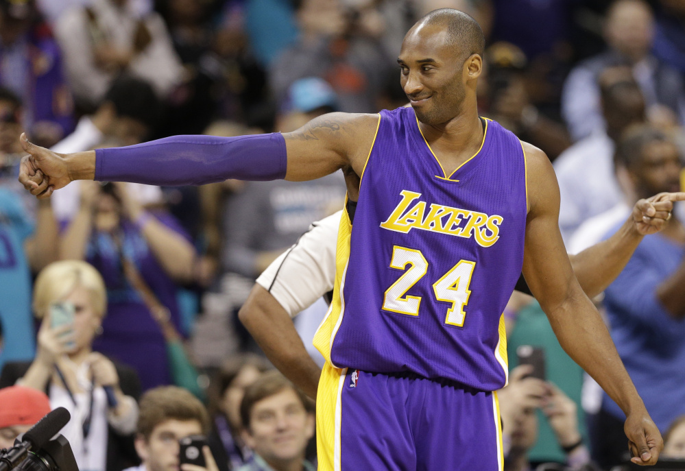 Kobe Bryant of the Los Angeles Lakers gives a thumbs-up before Monday's game against the Hornets in Charlotte, N.C. – one more stop on a farewell tour for the retiring superstar who comes to Boston on Wednesday.