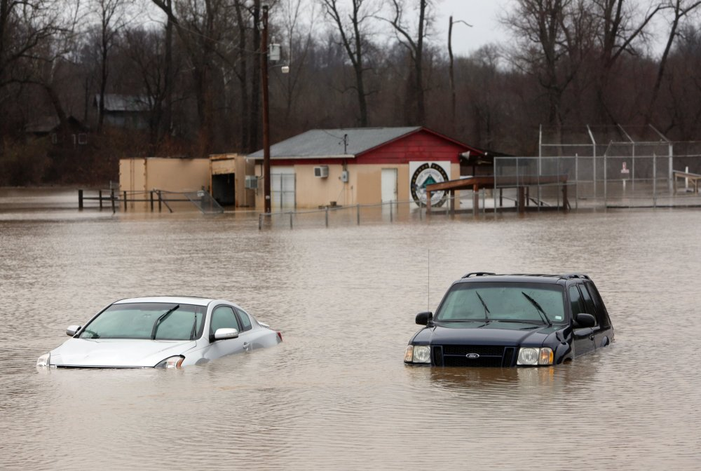Abandoned cars sit on the flooded parking lot of the Imperial Youth Association Ball Fields in Kimmswick, Mo.